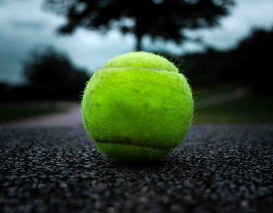 closeup of tennis ball on pavement
